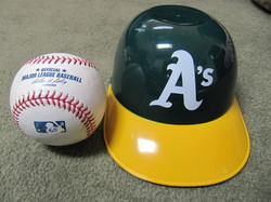 baseball and A's helmet