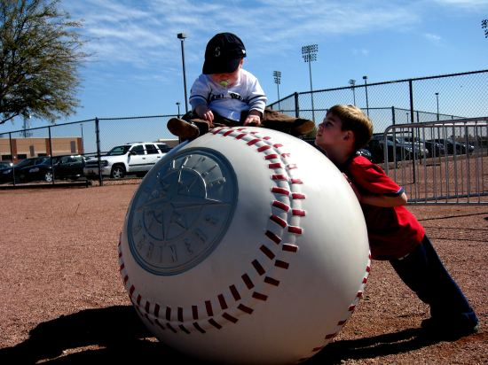 24 - Tim and Kellan on Mariners ball.JPG