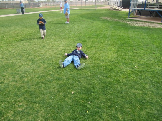 4 - Tim clowning around in grass.JPG